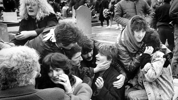 Mourners panicking at Milltown Cemetery, Belfast, after a gun and bomb attack by Michael Stone which left three people dead and four seriously injured during the funerals of three IRA membes shot dead in Gibraltar.  1988