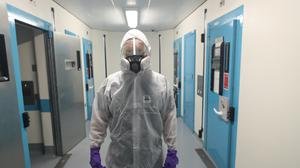 A member of the PSNI Musgrave Street custody team wearing the PPE