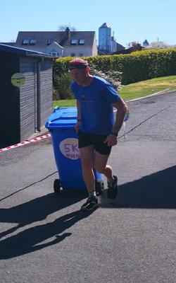 Keith Clarke completed a marathon in his backyard with a wheelie bin to raise money for the NHS. Photo (Keith Clarke PA)