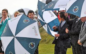 Rory shelters from the wind and rain