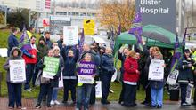 Workers stage a strike outside the Ulster Hospital yesterday