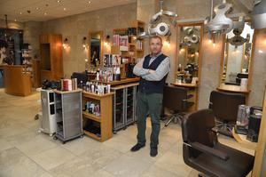 Keith in his salon, the last remaining business in the centre