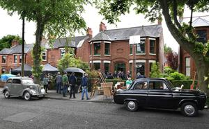 Filming in north Belfast yesterday, when vintage cars were also spotted