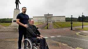 Ruairi Cummings with his father Christy Cummings who left paralysed from the chest down following a loyalist gun attack in December 1997 (Liam McBurney/PA)