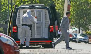 NOTE FACE PIXELLATED BY PA PICTURE DESK PSNI officers release someone from custody while operating in full PPE gear in Belfast. … Coronavirus – Wed May 13, 2020 … 13-05-2020 … Belfast … UK … Photo credit should read: Niall Carson/PA Wire. Unique Reference No. 53736887 … Picture date: Wednesday May 13, 2020. Photo credit should read: Niall Carson/PA Wire