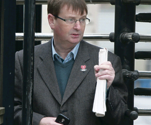 Flag protester Willie Frazer leaving court yesterday