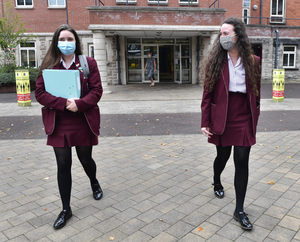 Back to class: Pupils from St Dominic's in Belfast return to school in September wearing masks