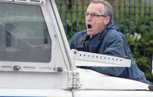 Sinn Fein's Gerry Kelly during the controversial incident with a police Land Rover last June