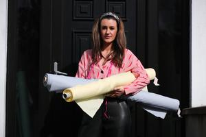 Belfast-based fashion designer Chloe Dougan is pictured leaving her home with material being used to make scrubs