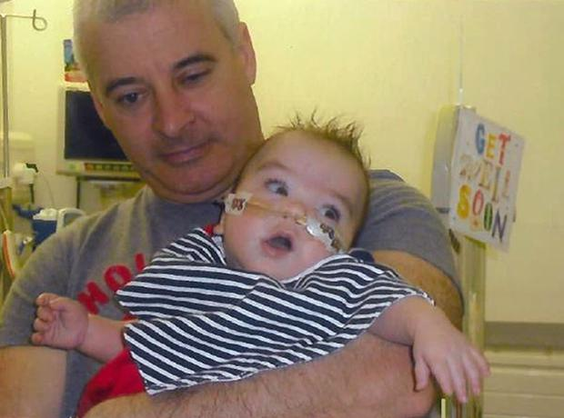 Kevin McGuigan with his grandson Ollie, who was in hospital in 2011 (Family handout/PA)