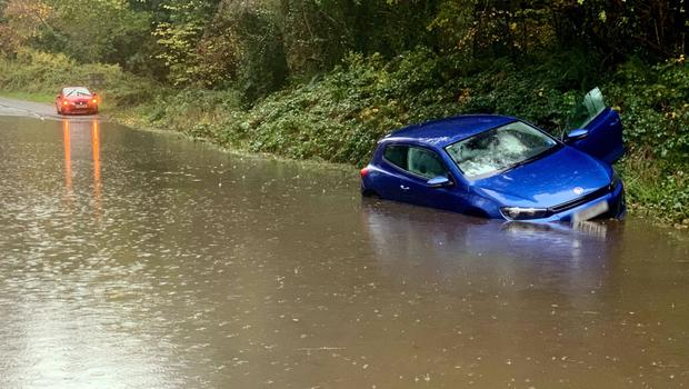 A motorist is stranded after flooding on the Finnebrogue Road in Downpatrick