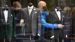 Ready: Shop assistants get a suit shop in Belfast ready for business