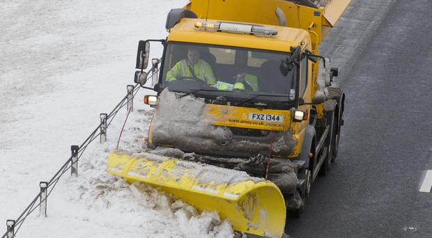 A snowplough gets to work on the A1 near Newry