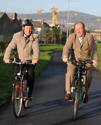 Former first minister Peter Robinson (left) and Steven Patterson, Northern Ireland's director of cycling along Belfast's Comber Greenway (OFMDFM/PA)
