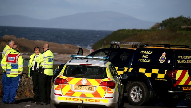PSNI and HM Coastguard at the scene of what appears to be a world war mine that has been washed up on Ballycastle beach late on Friday afternoon.