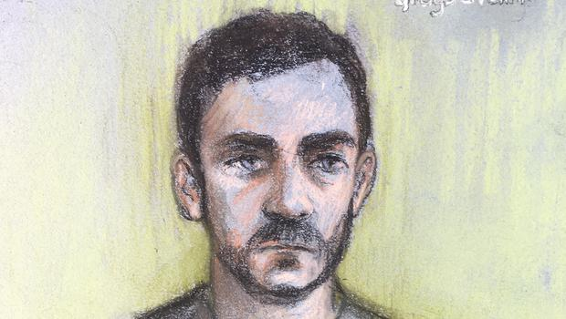 Court artist sketch by Elizabeth Cook of lorry driver Maurice Robinson, 25, on video-link at Chelmsford Magistrates' Court, Essex, where he has been remanded in custody after being charged with the manslaughter of 39 people found dead in a refrigerated container in Essex.