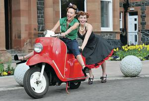 Denise Burt and Ciara Scullion test out a 1960s Velocette Viceroy at the launch of the 2014 Cultra Hillclimb at the Ulster Folk and Transport Museum