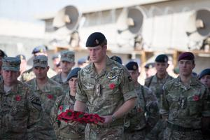 Prince Harry lays a wreath in Afghanistan