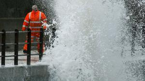 A man on the sea front in Saltcoats, Scotland, as the stormy weather hit parts of the UK.