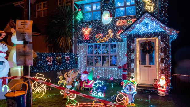 Dazzling: The house at Manor Wood in Londonderry, which has been transformed with Christmas illuminations to raise money for Foyle Search and Rescue.