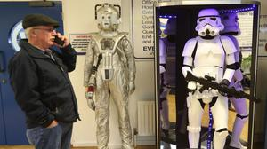 A member of the public views a Cyberman and a Stormtrooper among memorabilia items auctioned at Wilsons Auctions in Mallusk, Co Antrim