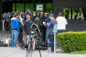 Journalists and TV crews gather outside Fifa headquarters in Zurich yesterday