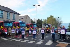 Hospital staff and firefighters outside Daisy Hill Hospital in Newry