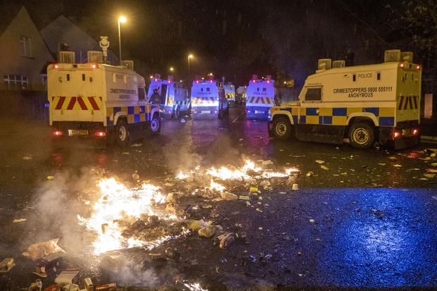 PSNI Tactical Support Group (TSG) officers in attendance during disorder in Londonderry (Liam McBurney/PA)
