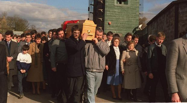 Mourners carry the coffin of Aiden McAnespie who was shot dead at an Army checkpoint in 1988