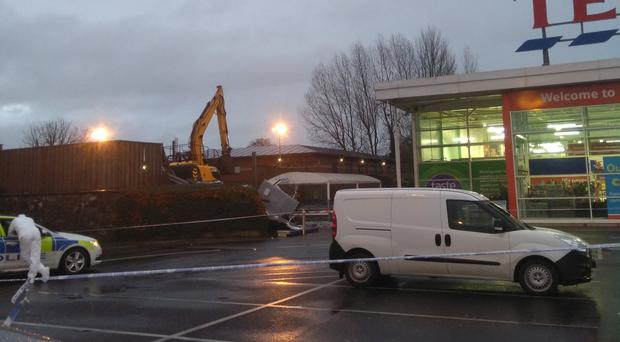 The scene at Tesco in Antrim after an ATM machine was stolen (Paul Michael/PA)
