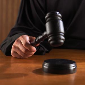 A tablet owned by the defendants was found to contain recordings of the victim in her workplace (stock photo)