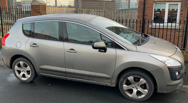 One of two cars reported stolen in the Cregagh Park East area of east Belfast (PSNI/PA)