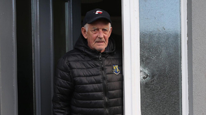 Target: Gerard Stevenson at the door of his house in Armagh which was damaged when devices were thrown at it