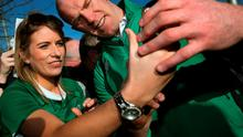 Ireland's captain Paul O'Connell poses for pictures with supporters on arrival at Dublin Airport yesterday