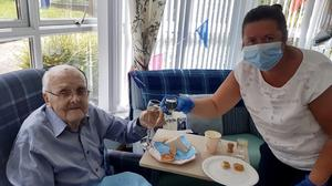 Tom Ferrett said he had a 'lovely day' on his 100th birthday, despite having to celebrate in lockdown (Abbeyfield and Wesley Housing Association/PA)