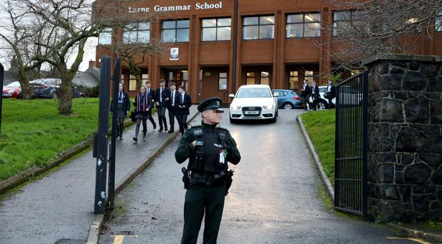 Police at Larne Grammar School after the stabbing incident earlier this month