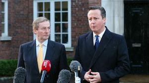 Taoiseach Enda Kenny and Prime Minister David Cameron speak to the media after talks at Stormont House in Belfast