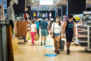 Customers wear masks as they shop