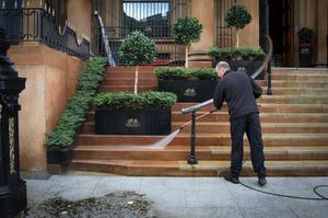 Cleaning the steps outside The Merchant Hotel