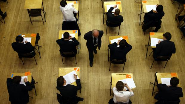 Five grammar schools in Northern Ireland have announced they will not use transfer tests to determine their 2021 intake (PA)