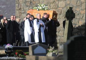 The coffin of Mollie Holmes is carried into the church