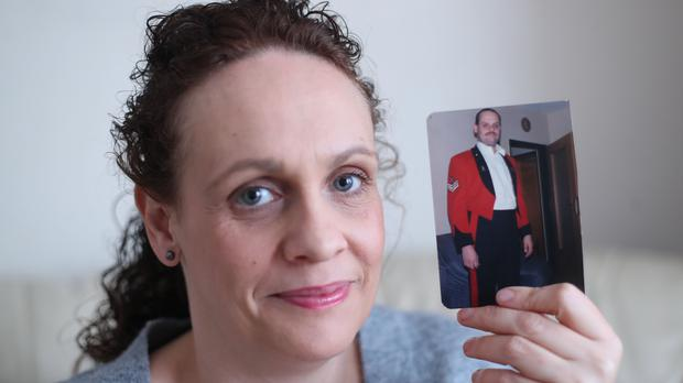 Michelle Rogers with a picture of her father Staff Sergeant Keith Rogers who fought in the first Gulf War (Niall Carson/PA)