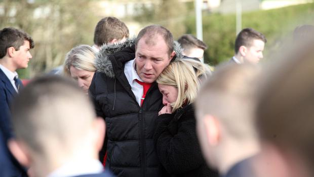 The parents of Deaglan Moran who was killed in a road accident say farewell to their son at his funeral at St Colmcille's Church, Downpatrick
