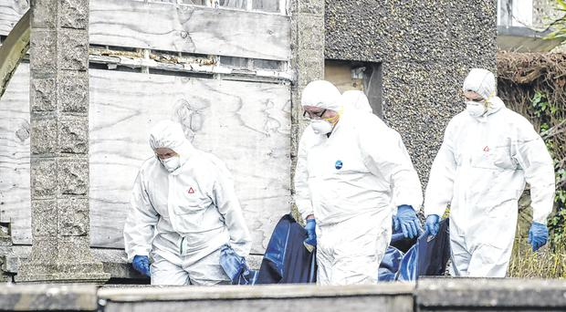 The remains of the deceased are taken from the scene at Castlegreina House