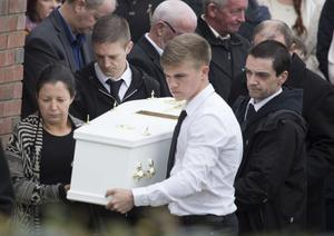 Louise McGrotty and brother Josh carry remains of their sister Jodi-Lee into their Hazelbank home