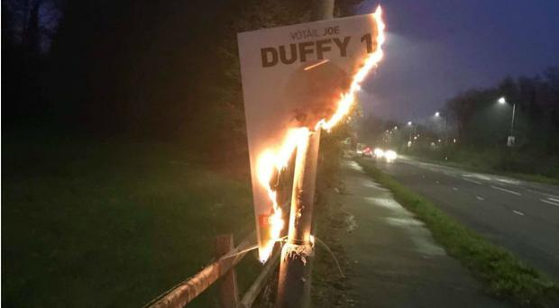 An image taken from the Twitter account of Cllr Ciaran Beattie of the poster on fire (PA)