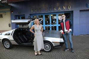 Strand Cinema CEO Mimi Turtle and staff member Steven Burrows welcome people to a screening of the 1985 classic Back to the Future last night