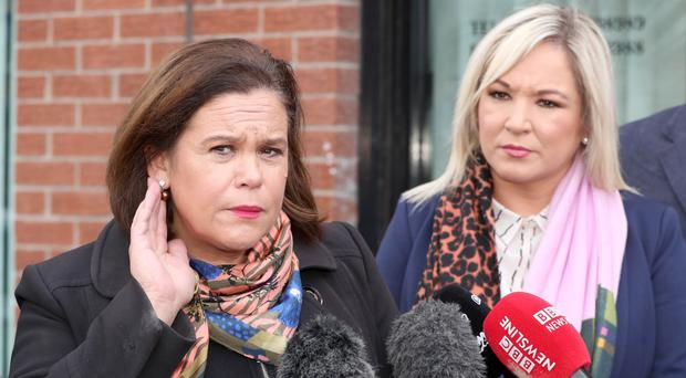 Sinn Fein's Mary Lou McDonald and Michelle O'Neill speak to the media in west Belfast yesterday