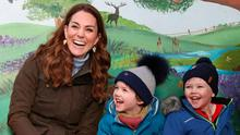 Catherine, Duchess of Cambridge, meets children from two local nurseries and (left and below right) animals including a lamb, snake and an alpaca, during a visit to The Ark Open Farm in Newtownards