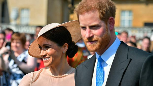 Meghan, Duchess of Sussex and with her husband Prince Harry, Duke of Sussex